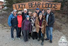 Group Photo Lazy Bear Lodge Sign